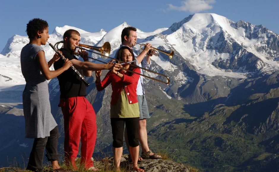 Young people playing trumpets in Verbier mountain