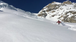man skiing off-piste