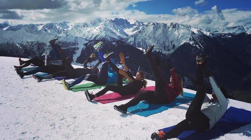 women doing yoga on the snow