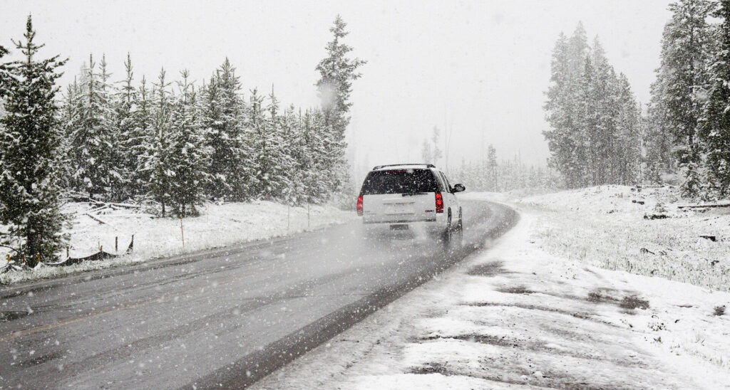Car in the winter road