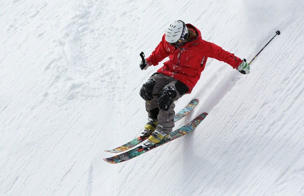 A man jumping with skiing in winter
