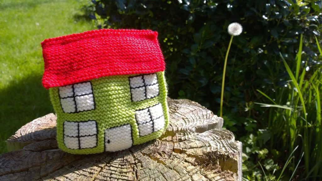 knitted house in the garden
