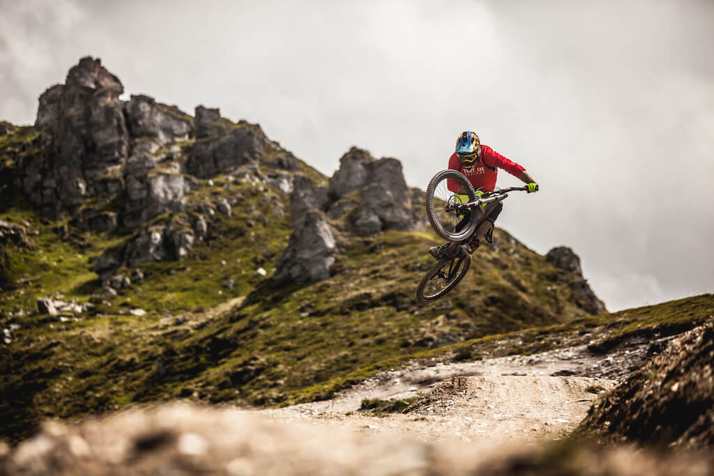 Man jumping with bike on a mountain