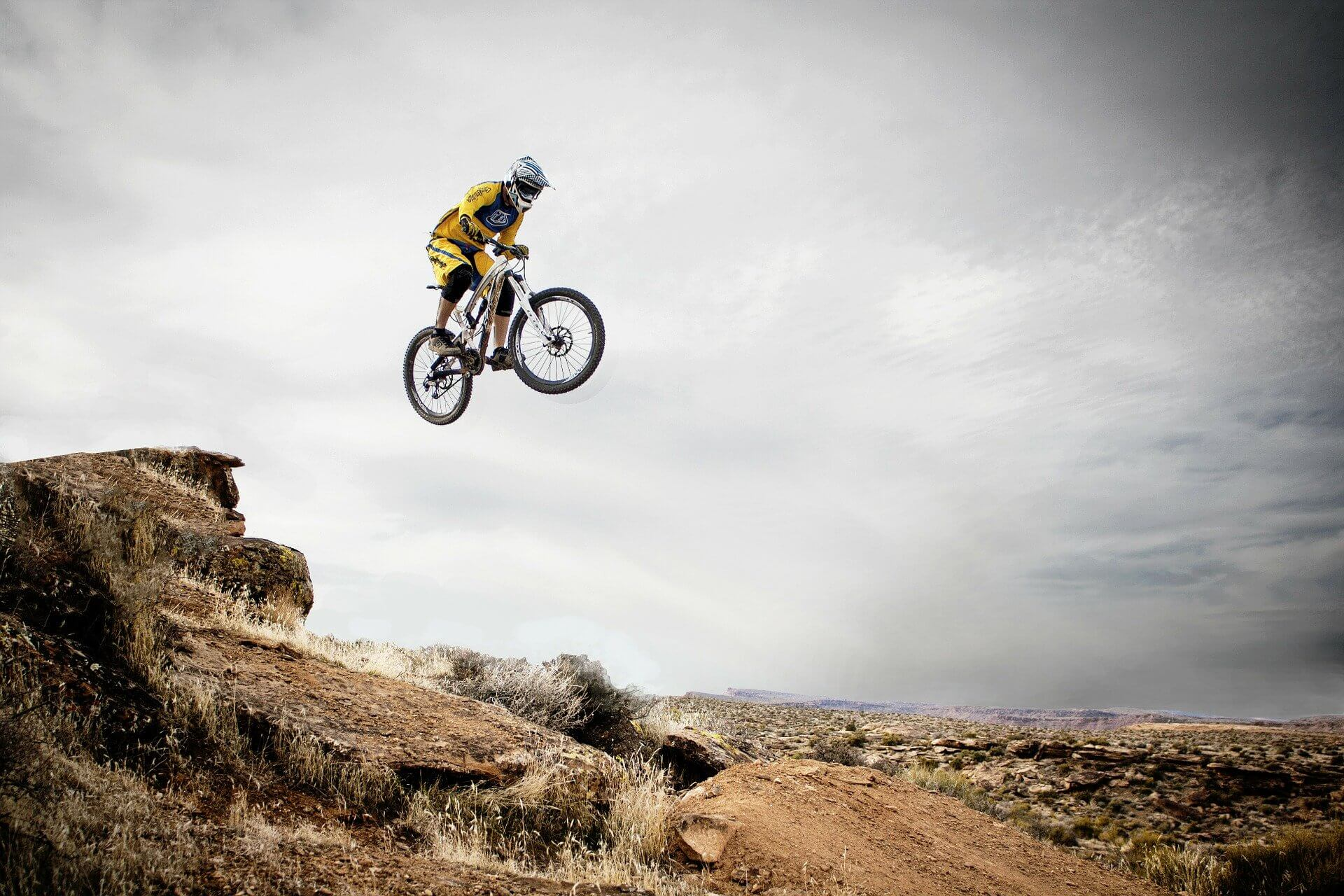A man jumping with a bike in the air