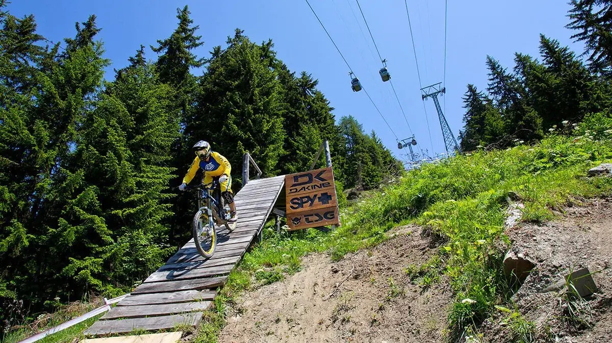 Man riding a bike on a mountain trail in Verbier